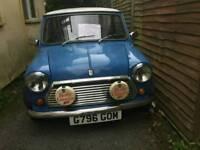 Blue classic mini city e auto