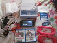 Sony PlayStation Vita pch-1003 Console bundle boxed with instructions,mains charger,2 GAMES