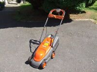 flymo lawnmower with grass box .