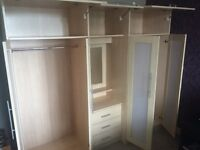 Bedroom Furniture - double wardrobe with joining mirror set of drawers and over head storage