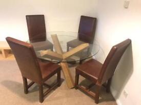 HEAL'S DESIGNER SOLID WALNUT AND GLASS ROUND TABLE WITH FOUR HEAVY LEATHER AND WOOD CHAIRS