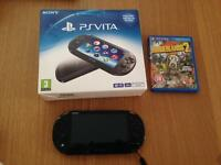 ps vita slim with 2 games & 16gb memory card