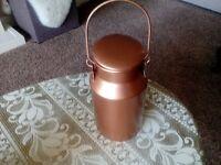 Copper colour small milk churn.