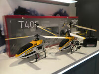 "Two RC Helicopters with cameras for sale. T40C model, large helicopter 30"" long."