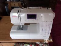 Janome sewing machinewith instruction book,many feet & stitches incl. buttonholer, needle threader