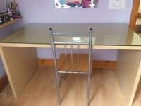 IKEA desk in birch with glass top and chair.