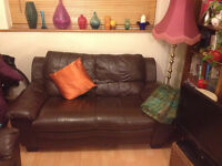 Two mathing brown leather two seater sofas
