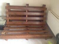 Wooden base for futon