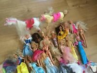 Huge bundle of Barbie and clothes accessories horses some Barbies have sound.
