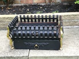 Cast iron fire basket with brass front legs