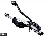 Thule roof bike carrier.