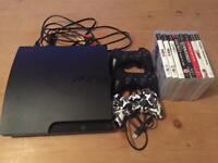PlayStation 3 with 8 games and 3 controllers