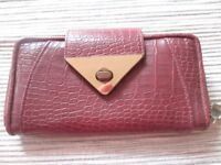 Long textured red purse