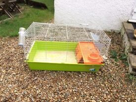 2x guinea pig cages for sale . one slightly bigger than other. with straw and wood chips
