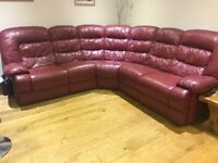 Red leather corner sofa with recliner on each end