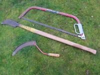 Cutting in the garden. Slasher axe, sickle and bow saw.