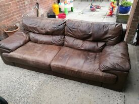 Large brown leather sofa. 3 seater