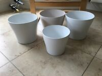 Four indoor white pottery plant pots