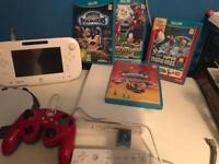 Wii u bundle with box including lots of sky landers And games