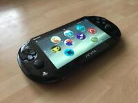 Ps vita console with games
