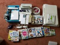 Nintendo Wii console + 3 controllers + fit board + lots of games
