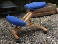 An adjustable kneeling chair
