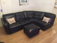 Black leather dfs corner sofa, armchair and storage puffet