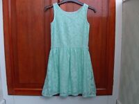 Green short sleeved lace dress