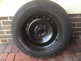Dunlop tyre part worn with rim
