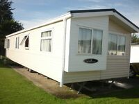 PRIVATE SALE SPACIOUS STATIC 2 BED CARAVAN IN EXCELLENT CONDITION SITED AT BREYDON WATER NORFOLK