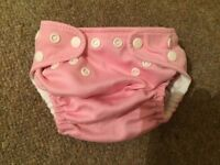 cloth nappies (12 Charlie Banana, 35 Smartipants) variety of colours good condition
