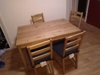 Solid pine dinning table and 4 chairs