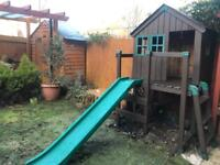 Wooden house with a slide