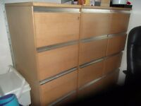 Wooden 4 drawer filing cabinet. Clean and in good condition.
