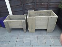 2 well made garden planters grey in colour