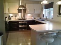 gloss brown and gloss cream kichen cabinet doors with worktops and breakfast bar