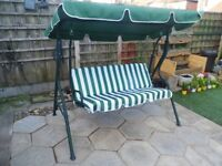 garden swing 2/3 seater new last year, green and white stripped