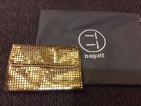 Stunning gold clutch/shoulder bag italian designer brand bagett