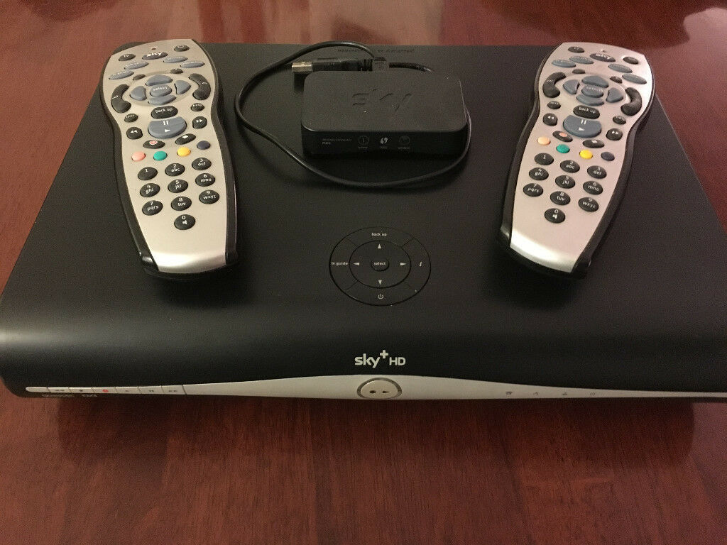 Sky+ HD Box, Mini Wifi Connector & cable, and 2 Sky Remote Controls.