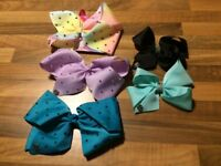 JoJo Siwa Bows 5 in total (1 brand new) (Small and large), good condition, pet and smoke free home
