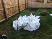 Top soil, including small amount of turf. Bagged up