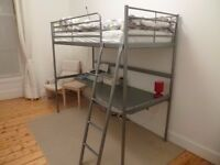 Ikea Svarta loft bed frame with desk top