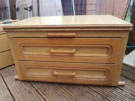 Caravan centre drawer unit with unfolding table.