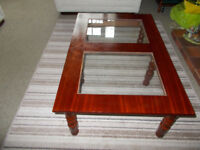 Coffee table with two glass inserts