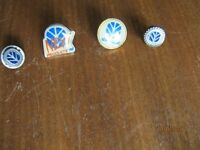 SET OF FOUR NEW HOLLAND LAPEL BADGES. £40