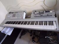 Korg M3, 88 key synthesizer with hard flight case.