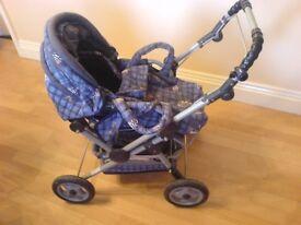 Dolls pram by Bayer. Blue teddy bear fabric, hood, reclining seat, cosy-toe.