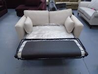 Brand New Beige 2 Seater Fabric Sofa Bed. Easy To Pull Down And Put Back Up. Can Deliver