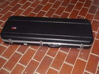 Solid carrying case for an electric guitar