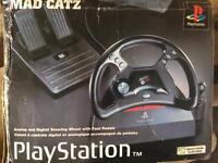 Play station steering wheel and foot pedals mad catz